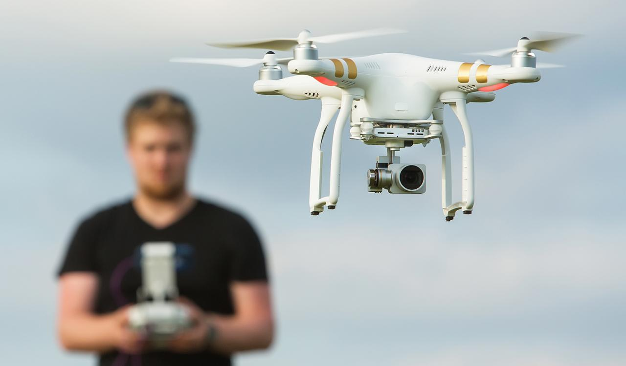 Man flying a micro drone.