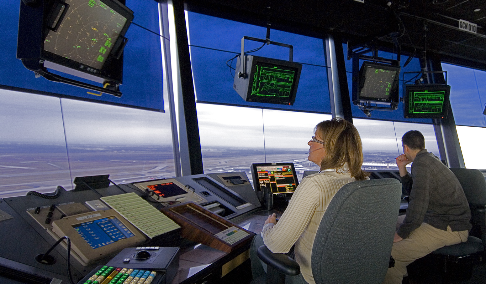 Air traffic controllers at work in control tower