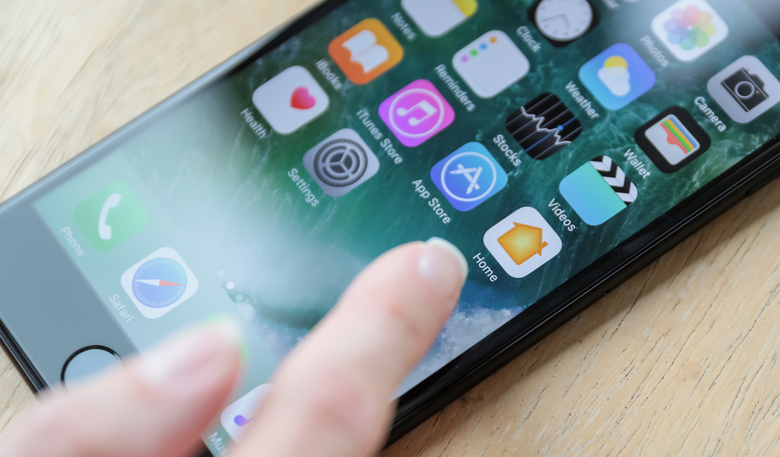 Finger touching iPhone