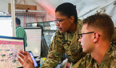 Soldiers looking at computer screen