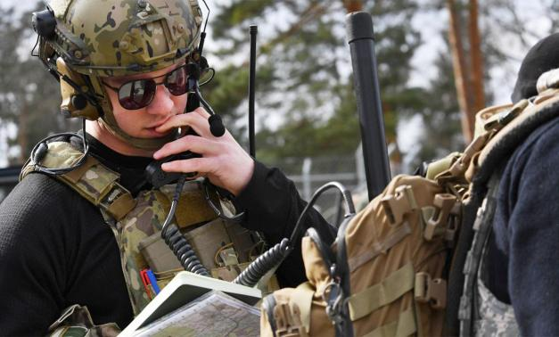 A U.S. Air Force Airman reviewing information.