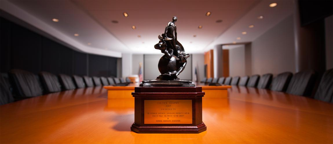 Collier Trophy on conference table.