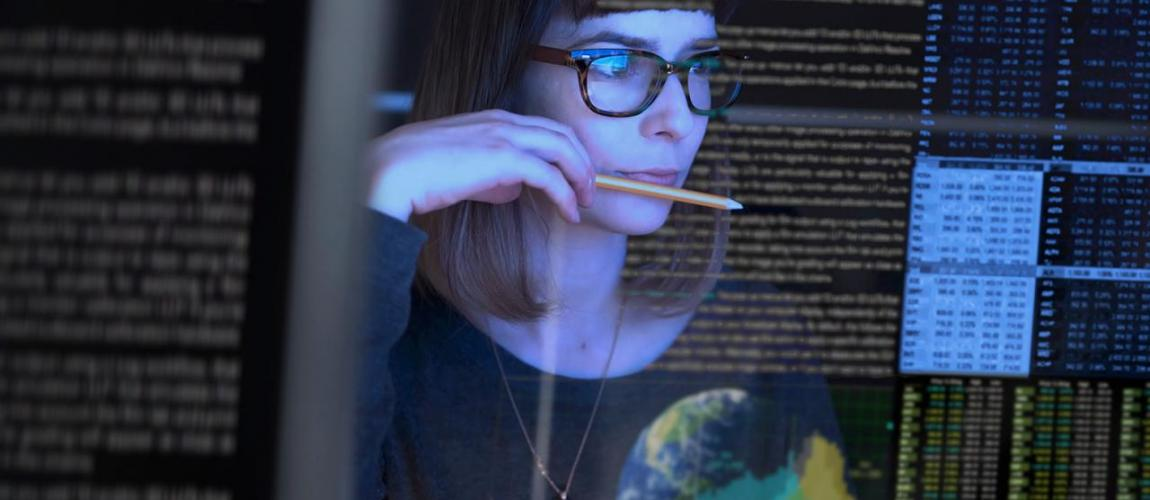 Woman reading data on a screen