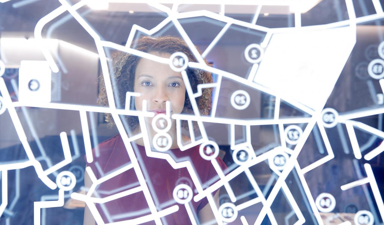 Woman looking at a clear screen with a map