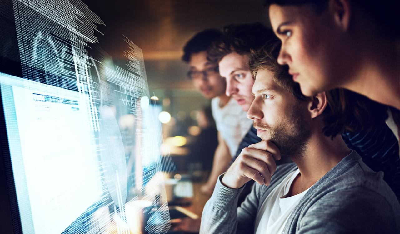 Young employees looking at a computer screen