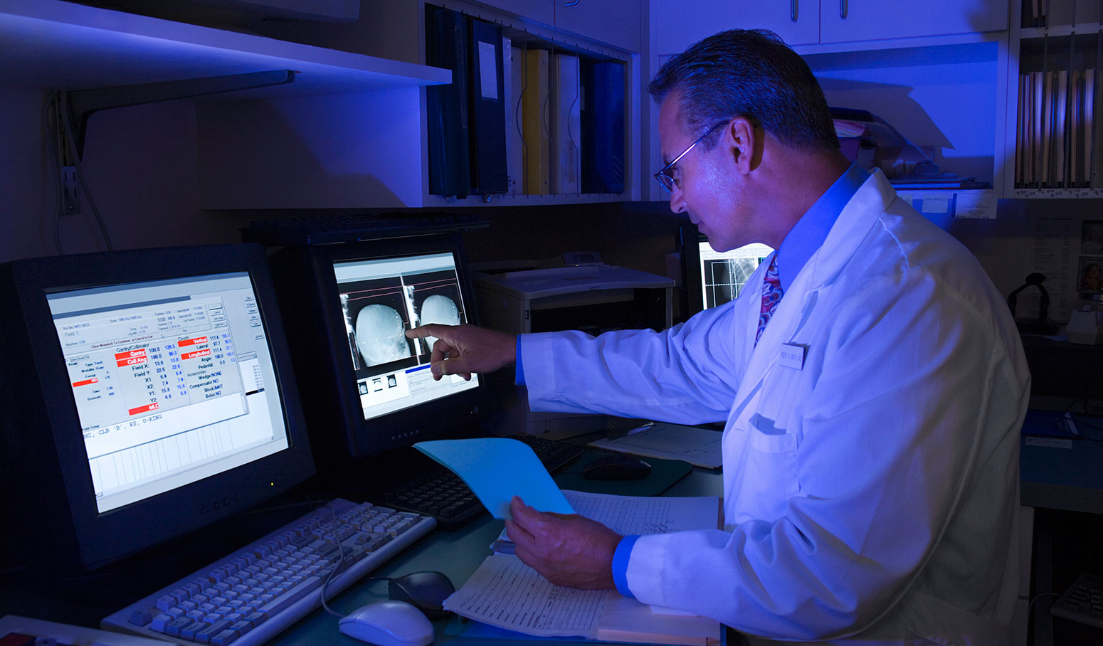 physician viewing computer screen