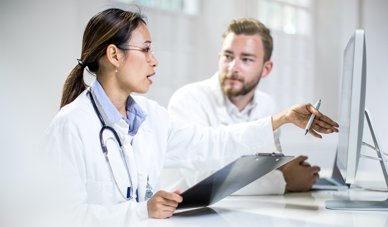 Two doctors reviewing health data