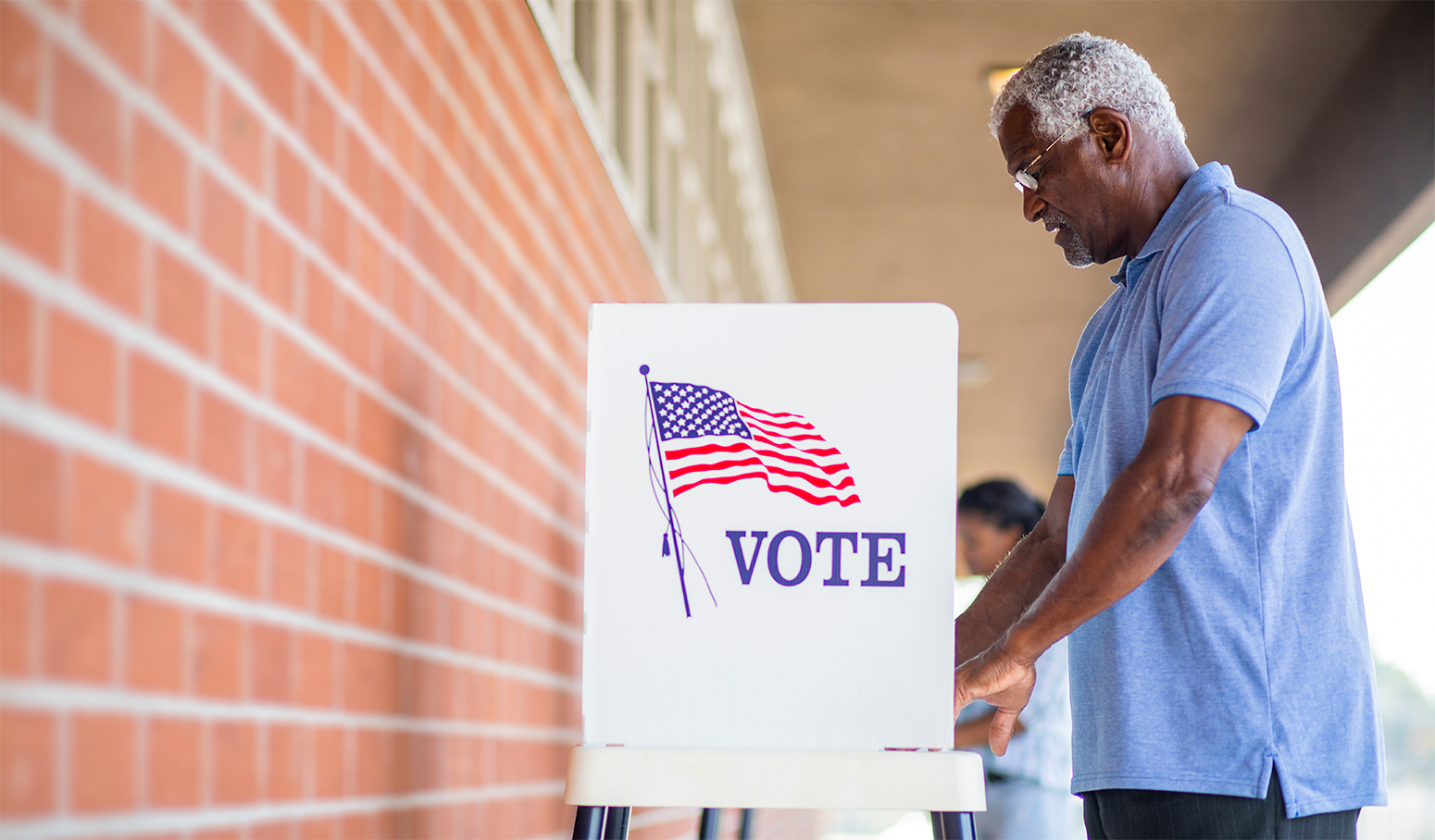 Man at a voting booth