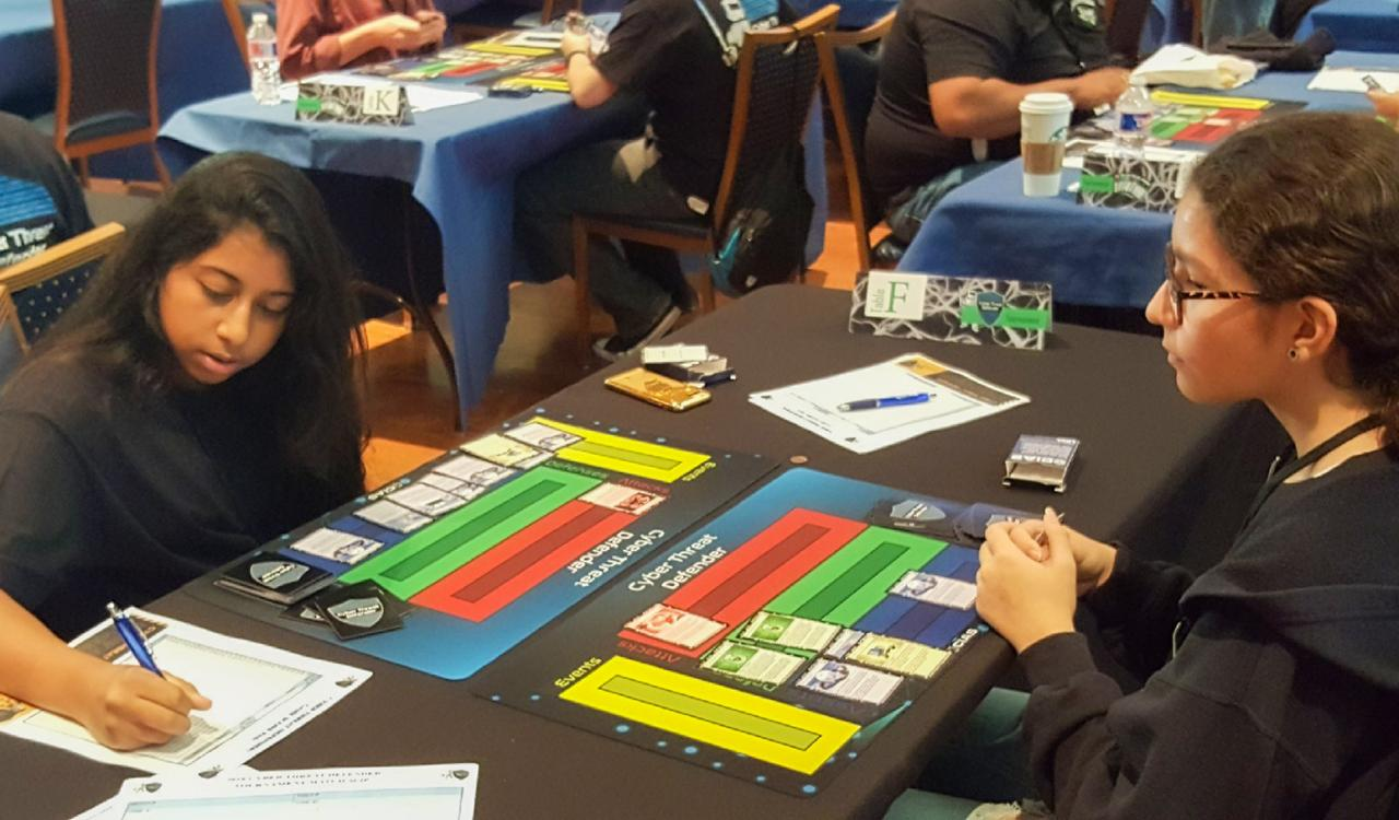 Students playing a cybersecurity card game at University of Texas San Antonio.