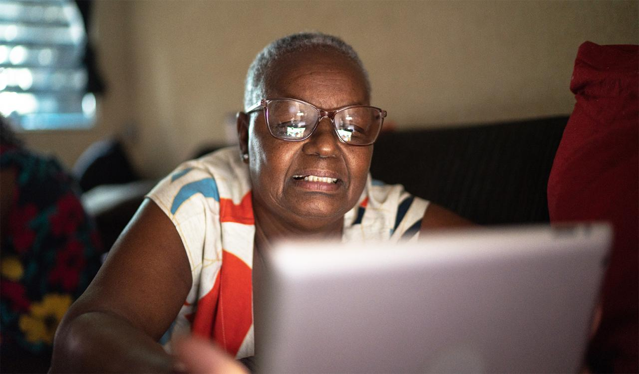 Older black woman using a computer to access mental health resources
