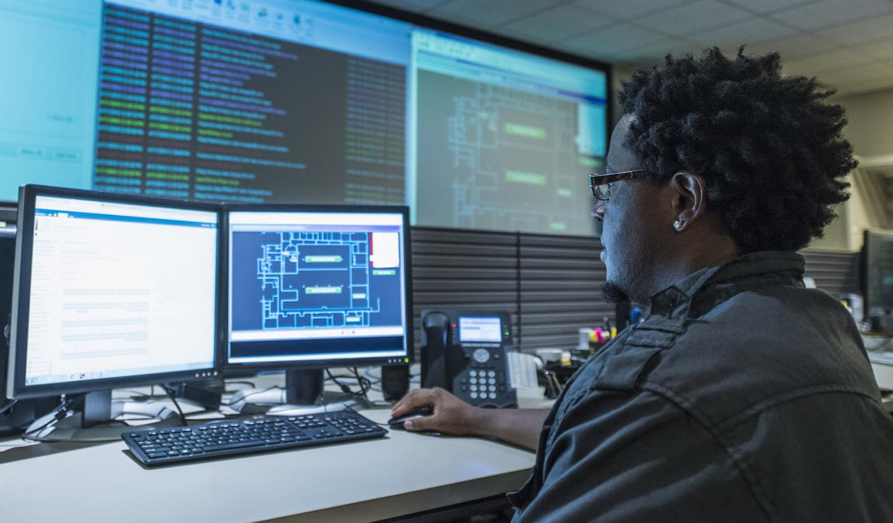 Man working at desk in server control room