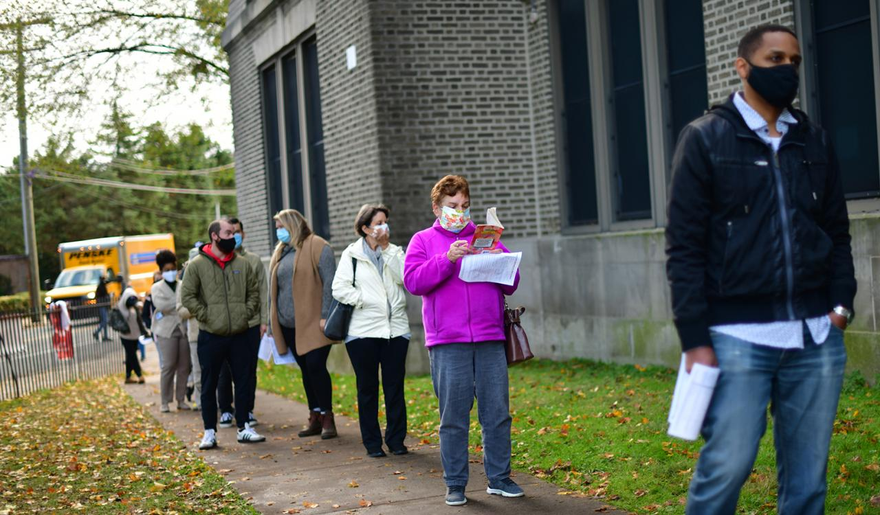 Voters waiting in line outside
