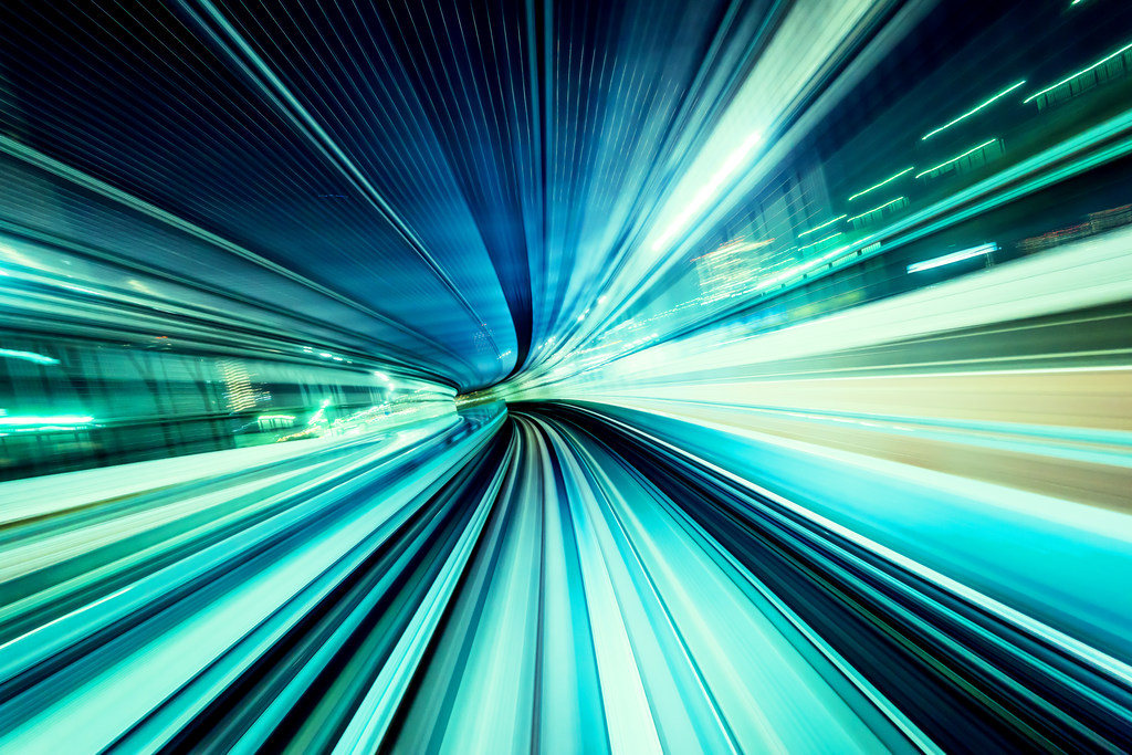 Warp speed with streaks of blue and green