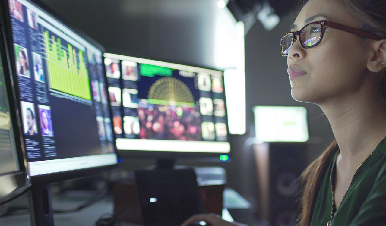 woman at computer working intently.