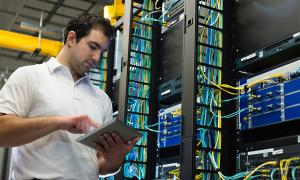 man making adjustments in data center