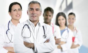 A group of five physicians of diverse genders and ethnicities