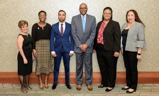 Six employees of The MITRE Corporation at the 2018 BEYA STEM Conference