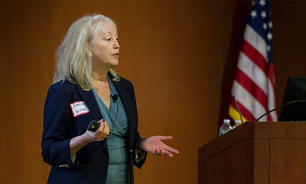 Marion Michaud speaking at a professional development meeting for the Boston chapter of the Society of Women Engineers (SWE).