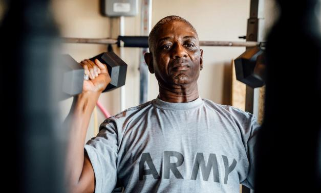 Army veteran working out in a gym.