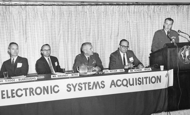 Panel sitting at a convention in 1963