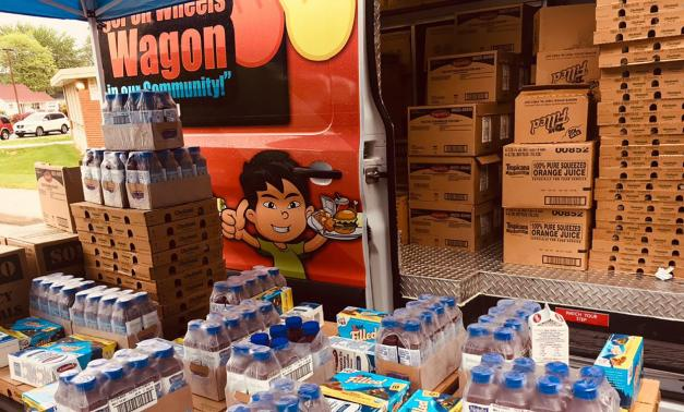 A mobile food bank with boxes of food ready for distribution