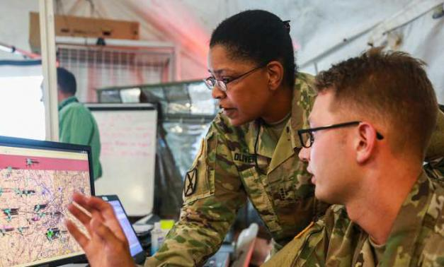 Army personnel looking at computer screens