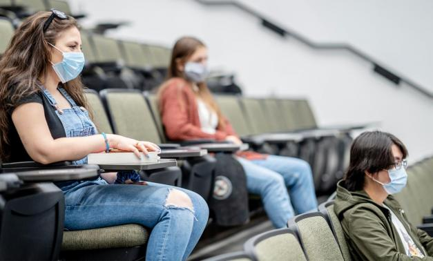 Masked students socially distanced in a classroom