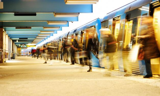 Commuters exiting a subway train
