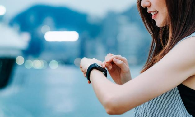 Woman wearing a fitness-tracking watch
