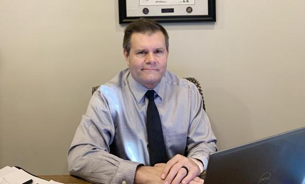 Mike Lewis sitting at his desk