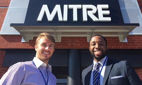 Two MITRE interns learn about healthcare policy.