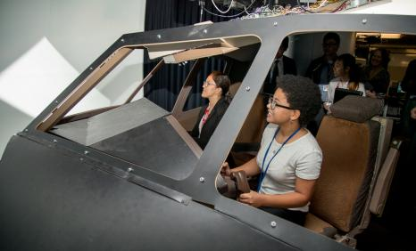 Virginia Tech students in a cockpit simulator