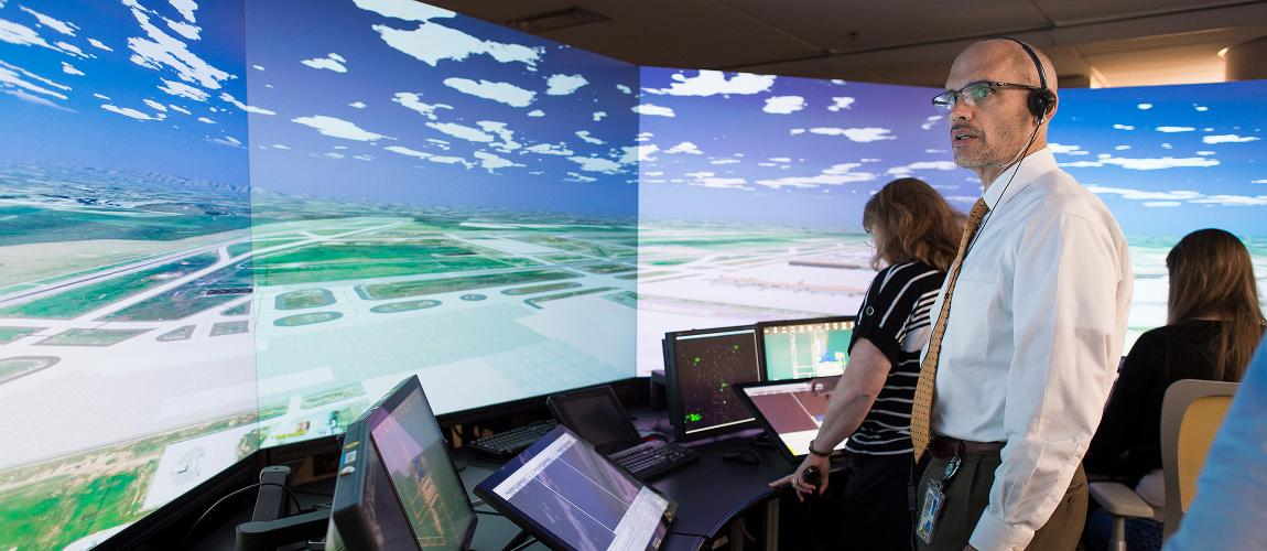 Employees working at the Air Traffic Control Tower simulator