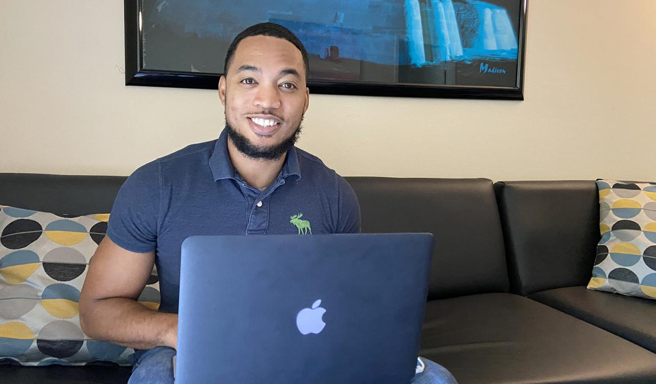 MITRE employee Marcus Herndon at his laptop.