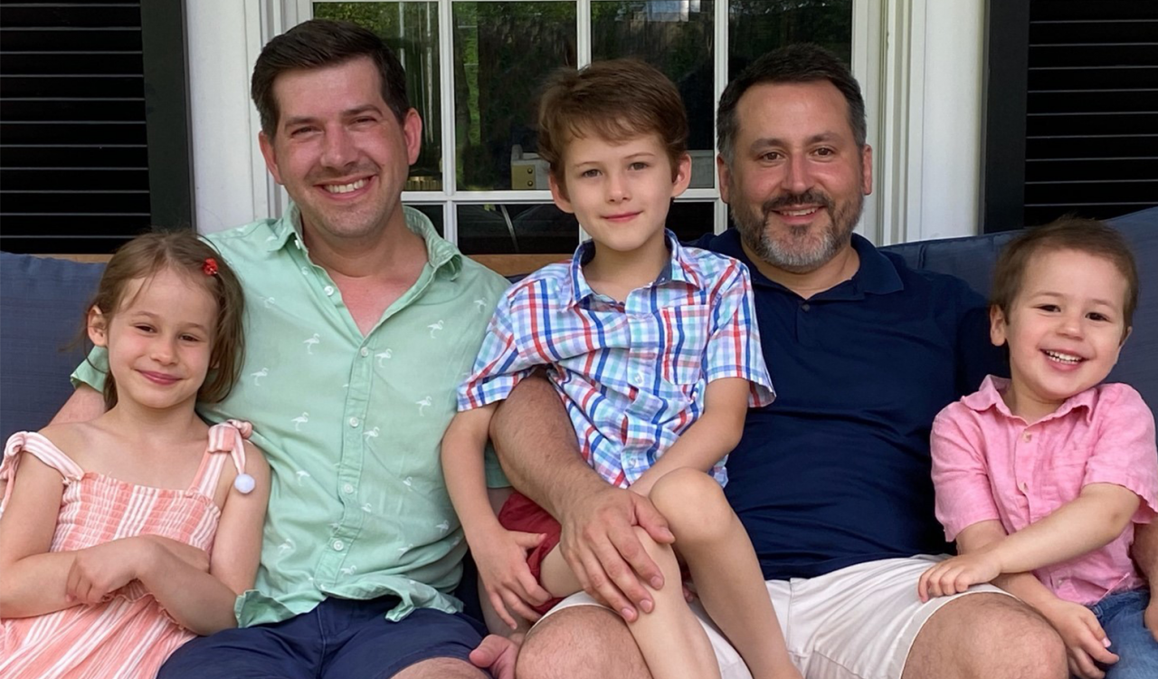 Charles Clancy (right, along with his husband Andrew and three children, Fiona, James, and Colin.